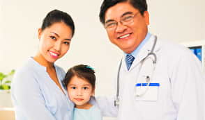 a doctor, a nurse, and a baby girl smiling