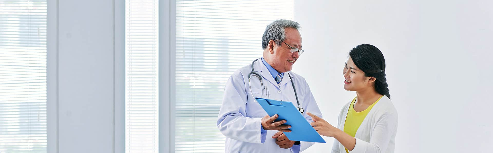 male doctor and a female nurse having a conversation